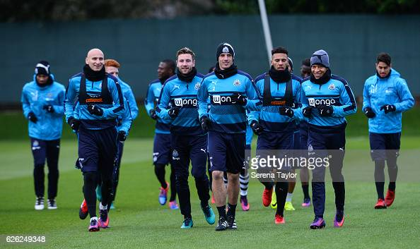 Newcastle players jog on the pitch during the Newcastle United Training Session at The Newcastle United Training Centre on November 28 2016 in...