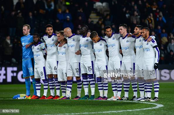 Newcastle players line up to pay respect for the victims of the colombian flight that crashed prior to kick off of the EFL Cup Quarter Final between...