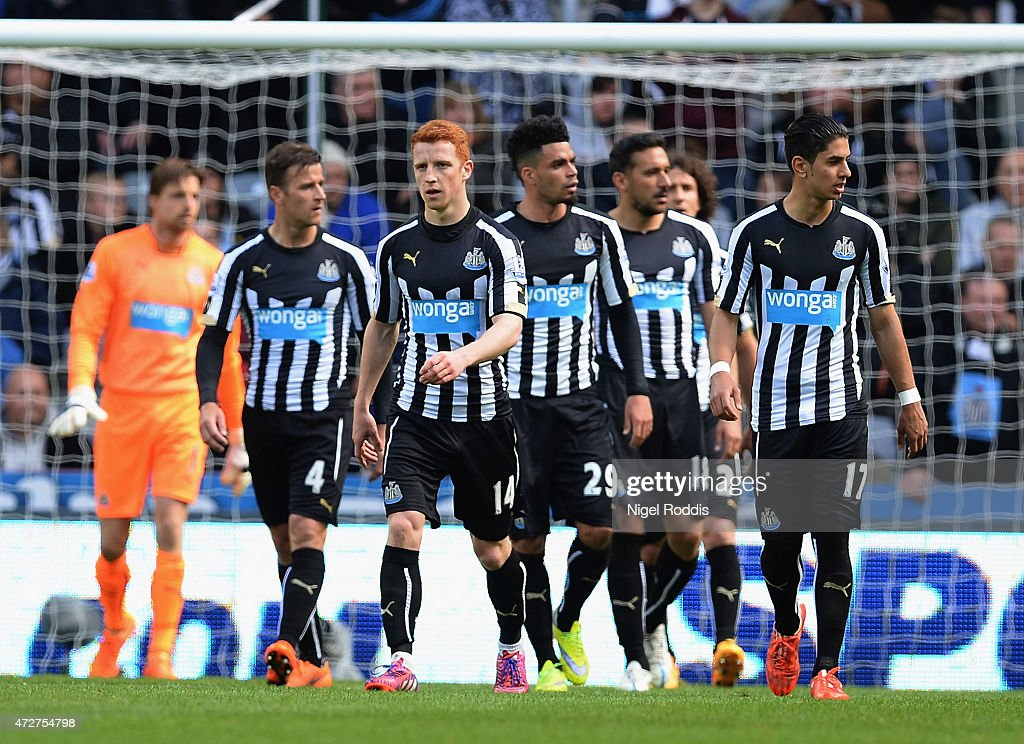 Newcastle players look dejected after the opening goal by Victor Anichebe of West Brom during the Barclays Premier League match between Newcastle...