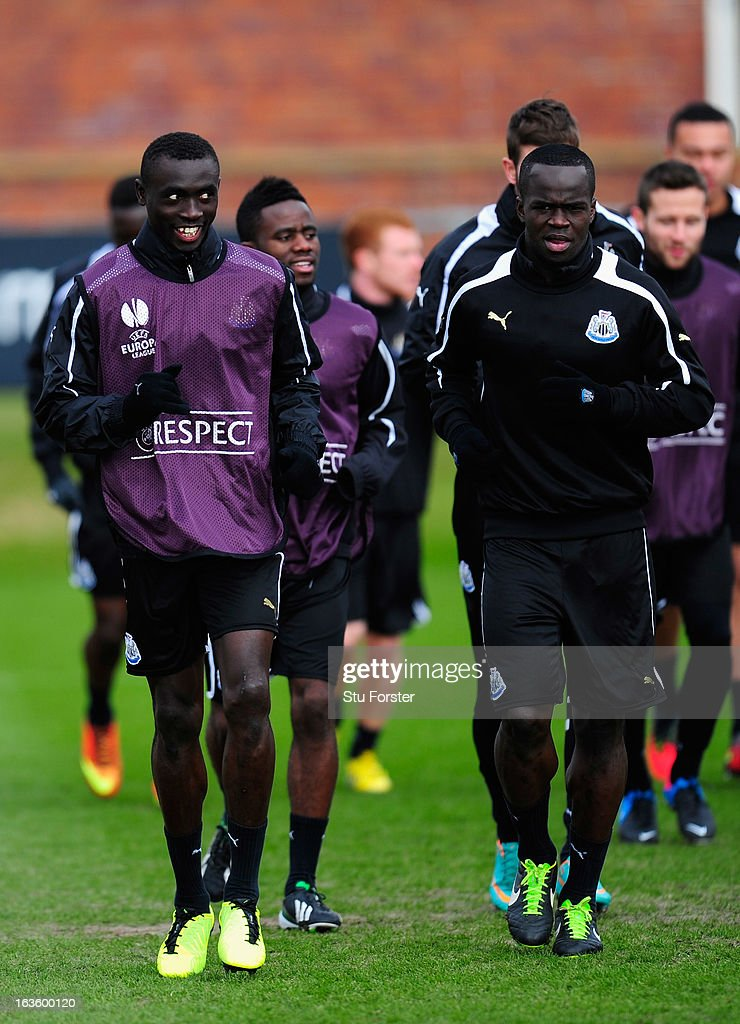 Newcastle players <a gi-track='captionPersonalityLinkClicked' href=/galleries/search?phrase=Papiss+Cisse&family=editorial&specificpeople=4251917 ng-click='$event.stopPropagation()'>Papiss Cisse</a> (l) and <a gi-track='captionPersonalityLinkClicked' href=/galleries/search?phrase=Cheick+Tiote&family=editorial&specificpeople=5490367 ng-click='$event.stopPropagation()'>Cheick Tiote</a> (r) share a joke during Newcastle United training at The Little Benton training ground on March 13, 2013 in Newcastle upon Tyne, England.