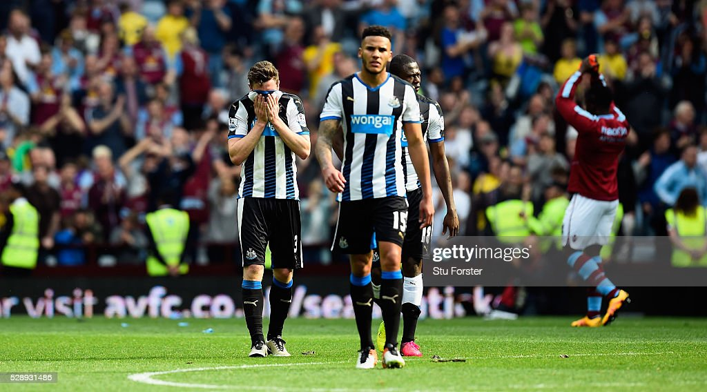 Newcastle players <a gi-track='captionPersonalityLinkClicked' href=/galleries/search?phrase=Paul+Dummett&family=editorial&specificpeople=6901267 ng-click='$event.stopPropagation()'>Paul Dummett</a> (l) <a gi-track='captionPersonalityLinkClicked' href=/galleries/search?phrase=James+Lascelles&family=editorial&specificpeople=217469 ng-click='$event.stopPropagation()'>James Lascelles</a> (c) and <a gi-track='captionPersonalityLinkClicked' href=/galleries/search?phrase=Chancel+Mbemba&family=editorial&specificpeople=11098951 ng-click='$event.stopPropagation()'>Chancel Mbemba</a> react after the Barclays Premier League match between Aston Villa and Newcastle United at Villa Park on May 7, 2016 in Birmingham, United Kingdom.
