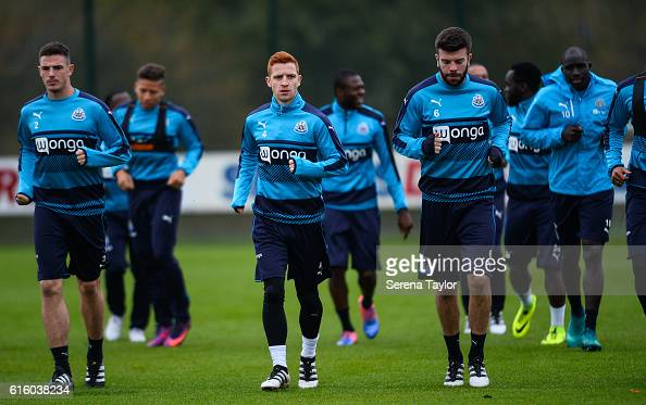 Newcastle players seen Ciaran Clark Jack Colback and Grant Hanley jog during the warm up of the Newcastle United Training Session at The Newcastle...