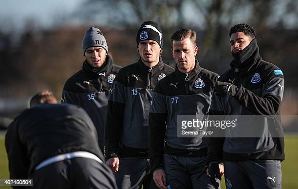 Newcastle Players seen left to right Mehdi Abeid Daryl Janmaat Ryan Taylor and Emmanuel Riviere watch Dave Billows give instructions during a...