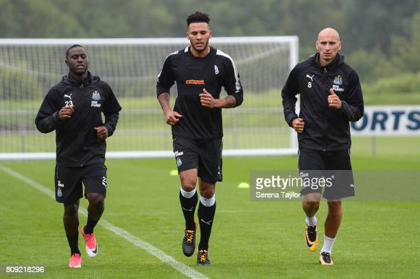 Newcastle players seen LR Henri Saivet Jamaal Lascelles and Jonjo Shelvey jog around the pitchduring the Newcastle United Training session at the...