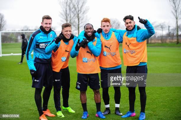 Newcastle players seen LR Paul Dummett Dwight Gayle Vurnon Anita Jack Colback and Ayoze Perez pose for a photo after winning a mini football...