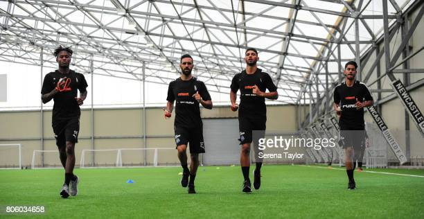 Newcastle players seen LR Rolando Aarons Jesus Gamez Achraf Lazaar and Ayoze Perez jog during the Newcastle United Training Session at the Newcastle...