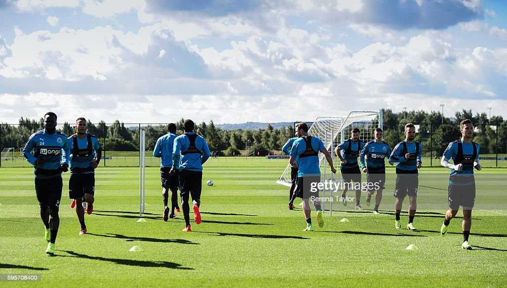 Newcastle Players warm up during the Newcastle United Training Session at The Newcastle United Training Centre on August 26 in Bristol England