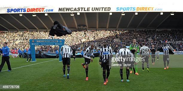 Newcastle players Yoan Gouffran Loic Remy Vurnon Anita Davide Santon Tim Krul Mathieu Debuchy Yohan Cabaye and Cheick Tiote remove their sweat shirts...