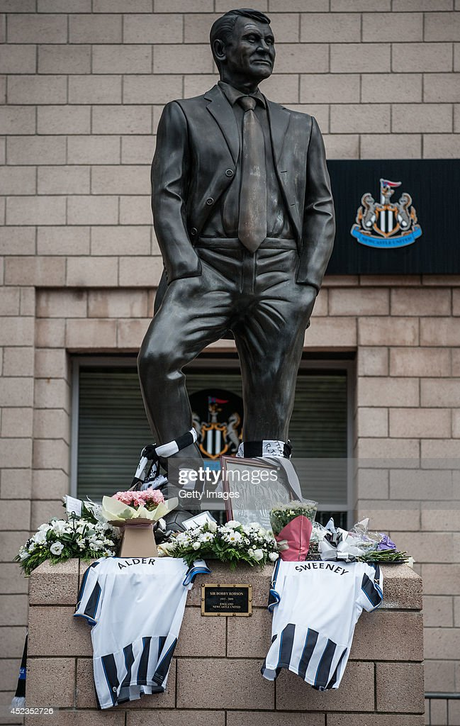 Newcastle shirts and flowers lay in memory of John Alder and Liam Sweeney victims of Malaysia Airlines crash at the Sir Bobby Robson Statue at...