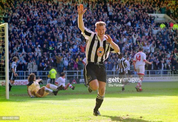 Newcastle striker Alan Shearer celebrates after scoring in the 77th minute as Sunderland goalkeeper Lionel Perez is left stranded during the FA...