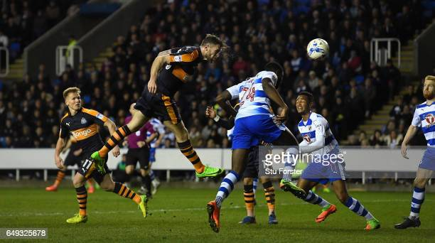 Newcastle striker Daryl Murphy gets a header in on goal during the Sky Bet Championship match between Reading and Newcastle United at Madejski...