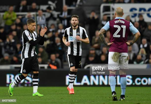 Newcastle striker Dwight Gayle leaves the field with a reaccurance of his hamstring injury during the Sky Bet Championship match between Newcastle...