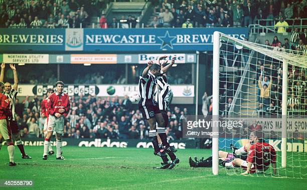 Newcastle striker Les Ferdinand celebrates after Darren Peacock scores the opening goal during the Premiership match between Newcastle United and...