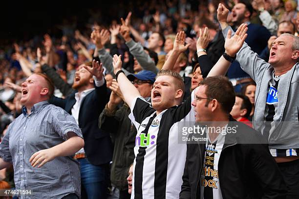 Newcastle supporters cheer after the Barclays Premier League match between Newcastle United and West Ham United at St James' Park on May 24 2015 in...