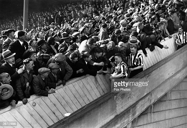 Newcastle United are congratulated by fans on their way down the steps at Wembley Stadium after the presentation of the FA Cup Trophy Newcastle won...