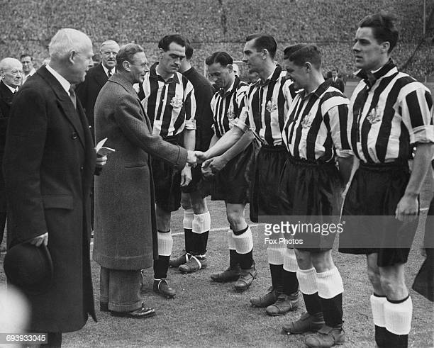 Newcastle United captain Joe Harvey introduces His Majesty King George VI to Newcastle United centre forward Jackie Milburn and the rest of the...