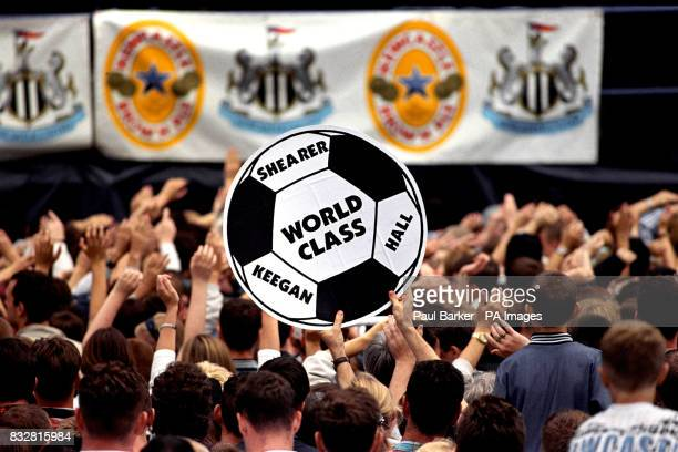 A Newcastle United fan holds up a sign proclaiming the world class combination of people at the top of the club as they welcome Alan Shearer to St...