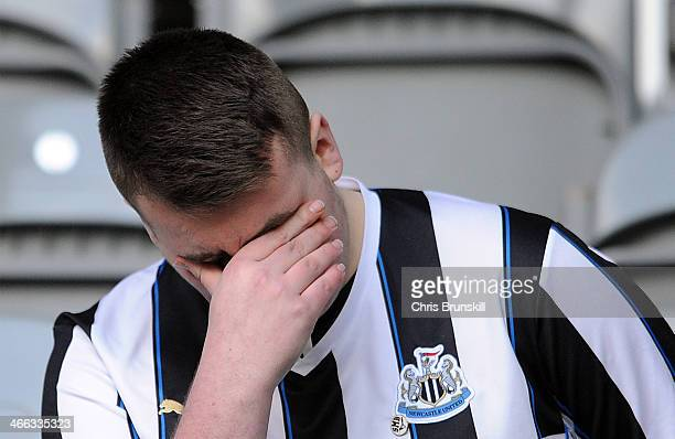 Newcastle United fan looks dejected following the Barclays Premier League match between Newcastle United and Sunderland at St James' Park on February...