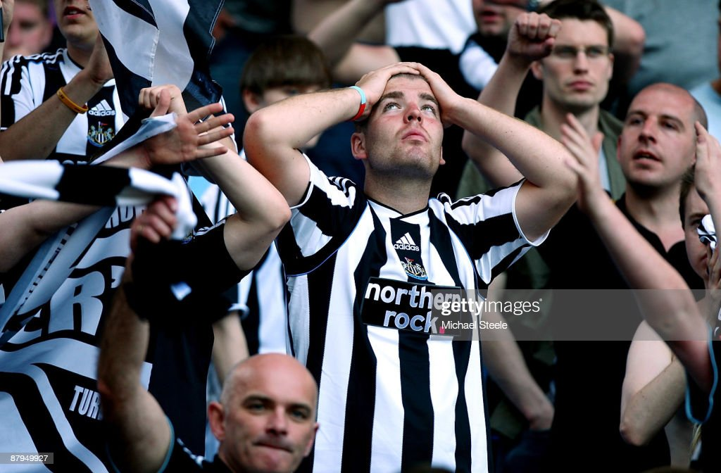 Newcastle United fan reacts after Newcastle United are relegated after their 01 defeat to Aston Villa during the Barclays Premier League match...