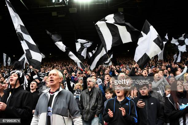 Newcastle United fans celebrate during the Sky Bet Championship match between Newcastle United and Barnsley at St James' Park on May 7 2017 in...