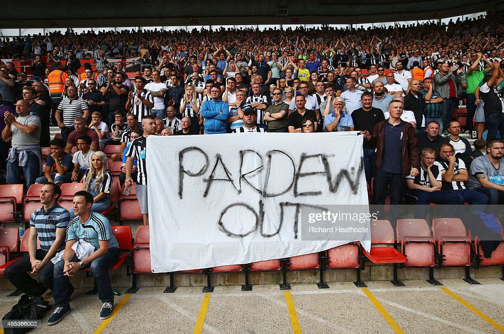 Newcastle United fans hold a 'Pardew Out' banner during the Barclays Premier League match between Southampton and Newcastle United at St Mary's...