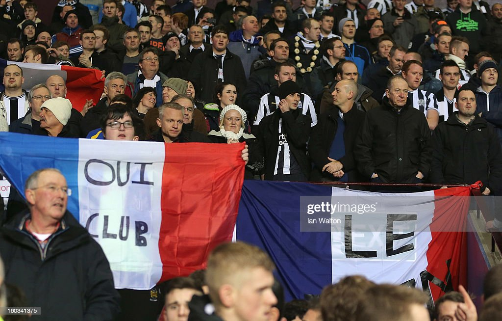 Newcastle United fans participate in a lighthearted demonstration at the influx of French players to the club during the Barclays Premier League match between Aston Villa and Newcastle United at at Villa Park on January 29, 2013 in Birmingham, England.