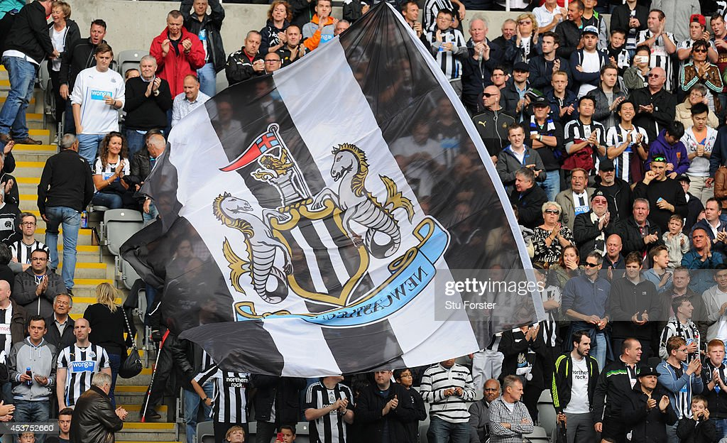 Newcastle United fans unveil a flag before the Barclays Premier League match between Newcastle United and Manchester City at St James' Park on August...