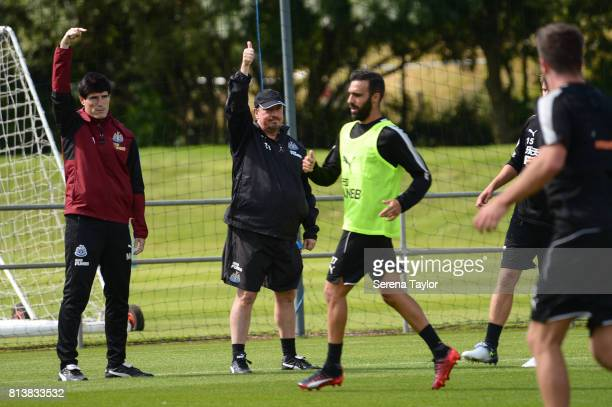 Newcastle United First Team Coach Mikel Antia and Newcastle United Manager Rafael Benitez hold their hands in the air to signal an out of bounds ball...