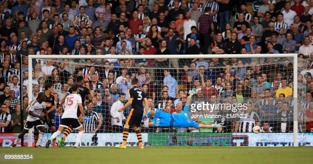 Newcastle United goalkeeper Matz Sels dives in vain as Fulham's Matt Smith scores the first goal of the game