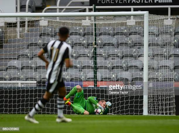 Newcastle United Goalkeeper Matz Sels dives to save the ball during the Premier League 2 Match between Newcastle United and Fulham at StJames' Park...
