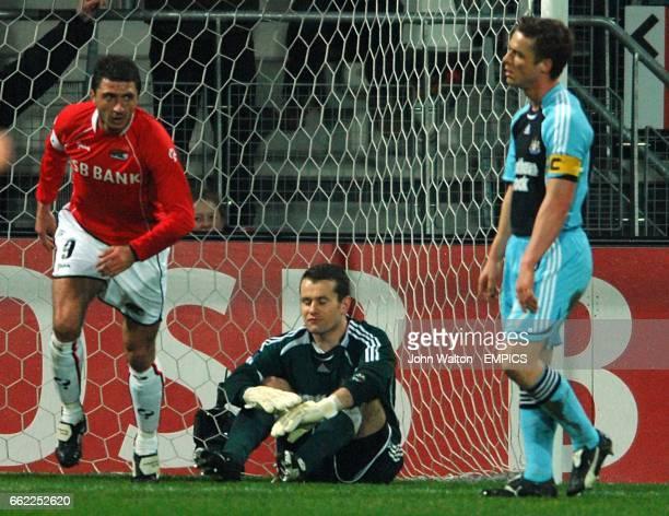Newcastle United goalkeeper Shay Given sits dejected having conceeded a goal to AZ Alkmaar's Shota Arveladze as Newcastle United's Scott Parker looks...