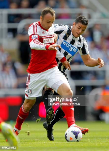 Newcastle United Hatem Ben Arfa and Fulham's Dimitar Berbatov battle for the ball