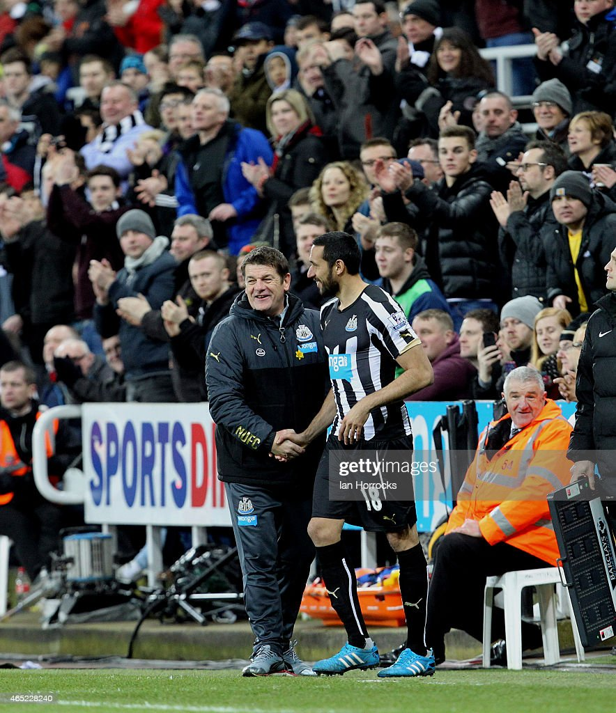 Newcastle United head coach <a gi-track='captionPersonalityLinkClicked' href=/galleries/search?phrase=John+Carver+-+Soccer+Manager&family=editorial&specificpeople=13829597 ng-click='$event.stopPropagation()'>John Carver</a> hands <a gi-track='captionPersonalityLinkClicked' href=/galleries/search?phrase=Jonas+Gutierrez&family=editorial&specificpeople=771739 ng-click='$event.stopPropagation()'>Jonas Gutierrez</a> of Newcastle United his comeback after recovering from cancer during the Barclays Premier League match between Newcastle United and Manchester United at St James' Park on March 04, 2015 in Newcastle upon Tyne, England.