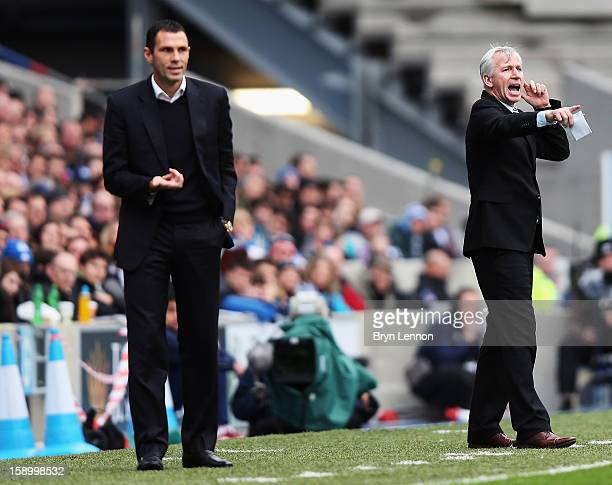 Newcastle United Manager Alan Pardew instructs his team as Brighton Hove Albion Manager Gus Poyet looks on during the FA Cup with Budweiser Third...