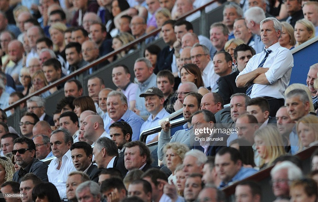 Newcastle United Manager Alan Pardew looks on from the stands after being sent from the touchline during the Barclays Premier League match between Newcastle United and Tottenham Hotspur at Sports Direct Arena on August 18, 2012 in Newcastle upon Tyne, England.