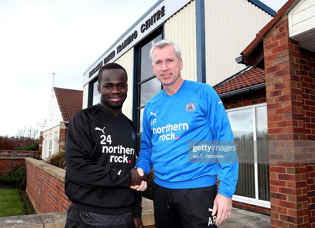 Newcastle United manager <a gi-track='captionPersonalityLinkClicked' href=/galleries/search?phrase=Alan+Pardew&family=editorial&specificpeople=171147 ng-click='$event.stopPropagation()'>Alan Pardew</a> (R) shakes hands with Cheik Tiote after the midfielder agreed a new contract on February 25, 2011 in Newcastle Upon Tyne, England.