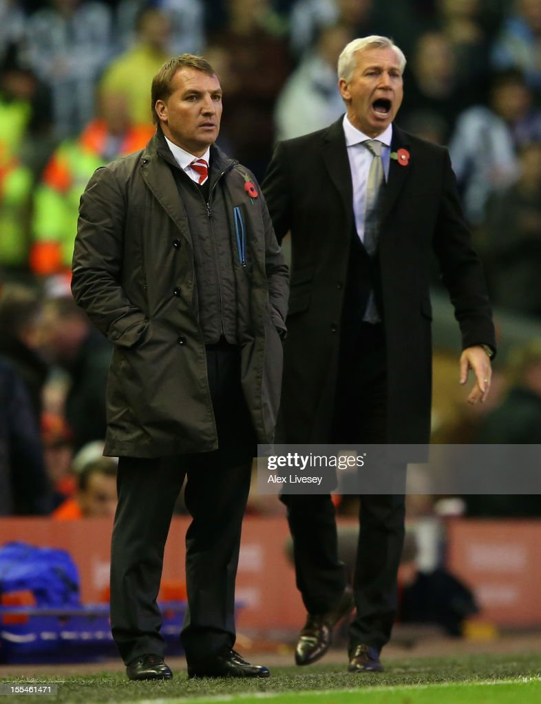 Newcastle United Manager Alan Pardew shouts instructions whilst Liverpool Manager Brendan Rogers looks on during the Barclays Premier League match between Liverpool and Newcastle United at Anfield on November 4, 2012 in Liverpool, England.