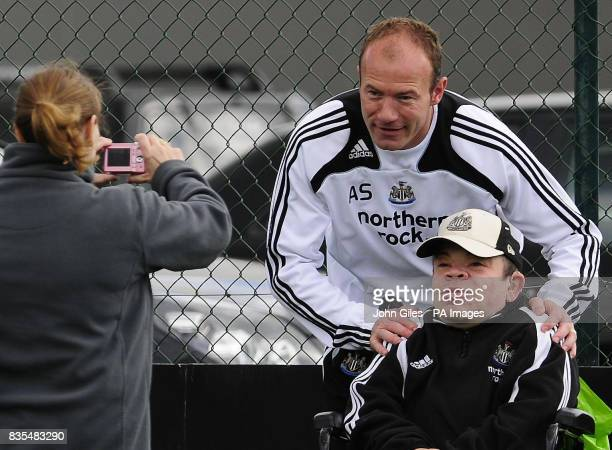 Newcastle United Manager Alan Shearer poses for a photograph with a fan during the training session at Longbenton Newcastle