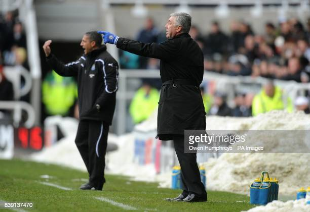 Newcastle United manager Chris Hughton and Chelsea manager Carlo Ancelotti direct their players from a snow covered touchline