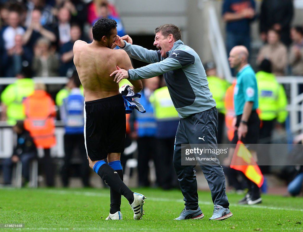 Newcastle United manager John Carver celebrates with goal scorer Jonas Gutierrez during the Barclays Premier League match between Newcastle United and West Ham United at St James' Park on May 24, 2015 in Newcastle Upon Tyne, England.