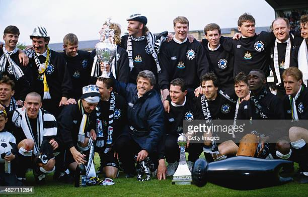 Newcastle United manager Kevin Keegan holds the League Division One trophy after the League Division One match against Leicester City at St James'...