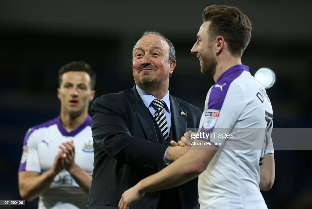 Newcastle United manager Rafael Benitez and Paul Dummett of Newcastle United after the final whistle of the Sky Bet Championship match between Cardiff City and Newcastle United at the Cardiff City Stadium on April 28, 2017 in Cardiff, Wales.