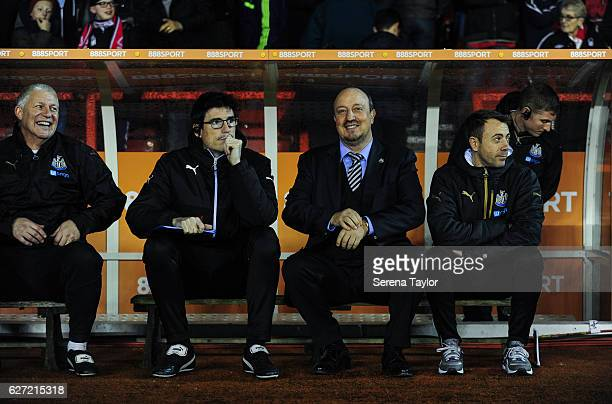 Newcastle United Manager Rafael Benitez sits in the dugout with staff seen LR Simon Smith Mikel Antia and Francisco de Miguel Moreno prior to kick...
