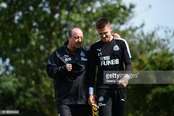 Newcastle United Manager Rafael Benitez walks outside with Goalkeeper Freddie Woodman during the Newcastle United Training session at the Newcastle...
