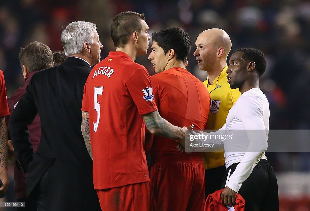 Newcastle United Manager speaks to Referee Anthony Taylor at the end of the Barclays Premier League match between Liverpool and Newcastle United at Anfield on November 4, 2012 in Liverpool, England.
