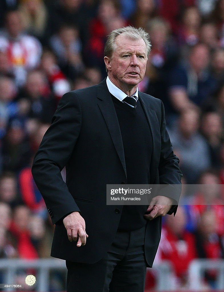 Newcastle United manager Steve McLaren stands on the side line with his fingers crossed as his team are 2 goals down during the Barclays Premier League match between Sunderland AFC and Newcastle United FC at the Stadium of Light on October 25, 2015 in Sunderland, United Kingdom.