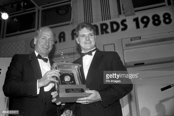Newcastle United midfielder Paul Gascoigne recieves his trophy from Manchester United and England hero Bobby Charlton at the PFA awards in London