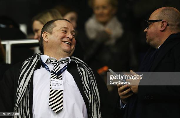 Newcastle United owner Mike Ashley and managing director Lee Charnley look on from the stand prior to the Barclays Premier League match between...