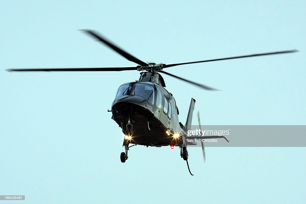 Newcastle United owner Mike Ashley arrives by helicopter during a Newcastle United training session at The Little Benton training ground on January 31, 2013 in Birmingham, England.