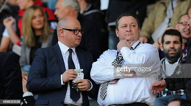 Newcastle United owner Mike Ashley chats with managing director Lee Charnley before the Barclays Premier League match between Swansea City and...